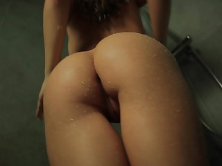 Hot busty babe lusciously dancing in the shower