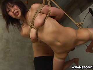Duteous Asian bimbo Kana Sato gets roped and sucks cock