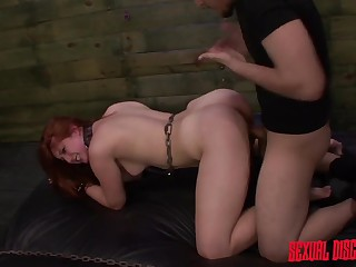 Rough treatment of a submissive redhead in his prison