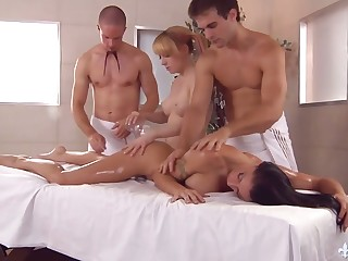 Two masseurs fuck killing hot busty chicks on the massage directors and cum on their faces