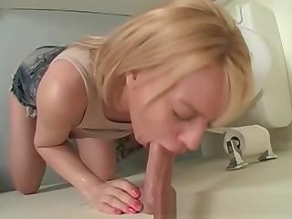Cute blonde masturbates upskirt unaffected by gloryhole