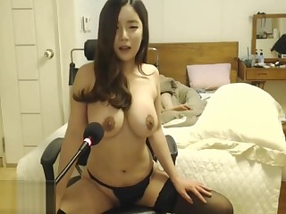Korean beauty in stockings plays with her huge tits