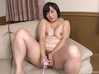 Big Japanese mature sucks dick and swallows