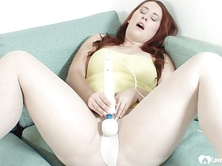 Redhead connected with white pantyhose uses a Hitachi
