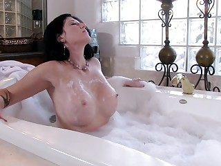 Busty brunette Licious Gia plays wide her boobs and pussy in the tub