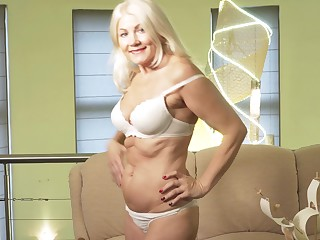 Sylvie is a smoking hot blonde who loves massaging her wet pussy