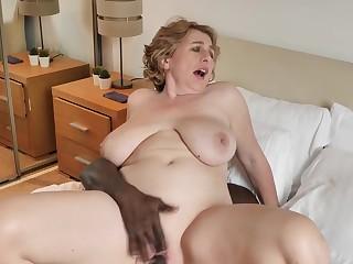 Fat mature Camilla Creampie enjoys riding a large black manhood
